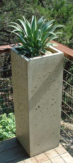 tall and slim concrete flower pot