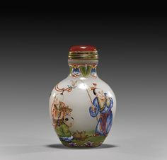 """ENAMELED GLASS SNUFF BOTTLE Unusual Qianlong-style enameled glass snuff bottle; of ovoid form: with a continuous figural scene of five boys playing in a garden, with inscription and seal mark; with metal mounted carnelian glass stopper; H: 2 1/4"""""""
