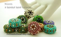 Discos is a peyote stitch disc shaped beaded bead tutorial with step by step instructions and 17 process photos. A sample page is pictured above. This is an Intermediate skill level project, but Advanced Beginners with a working of knowledge of Circular Peyote Stitch should be able to accomplish it. Buyer Reviews for this tutorial: Pattern is easy to follow. Highly recommended! These are so much fun. Im addicted! Love these patterns, very friendly and well written!!! Fantastic This tutorial…
