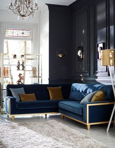 Lovely corner sofa.  Modern take with the gold but still has quilted back