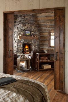 Cabin bedroom with cool pocket doors that open to the living room