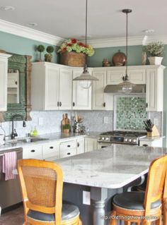 I like the different tile behind the stove top, rather than the same as the backsplash.