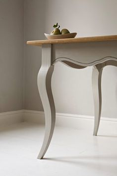 Another glimpse of Cornforth White (on the walls) by Farrow and Ball.  The table is painted with Lamp Room Gray.