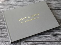 Bespoke Album Company - PERSONALISED A5 WEDDING GUEST BOOK IN MINK SATIN CLOTH 14.8cm x 21cm LANDSCAPE, £45.00 (http://store.bespokealbumcompany.com/classic-personalised-wedding-guest-book-in-mink-satin-cloth/)