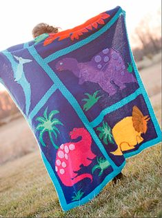 Nicky's Dino Mania includes both patterns for a fabulous child's Afghan, as well as the pattern for some adorable kid's sweaters!