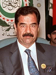 Saddam Hussein Abd al-Majid al-Tikriti (4/28/1937 – 12/30/2003) was the 5th President of Iraq from 7/16/1979 until 4/9/2003. He was also PM until 3/23/1991 and then again on 5/24/1991 until his capture on 12/13/2003.  He suppressed all oppisition, particularly the Shi'a and Kurdish movements, and maintained power during the Iran–Iraq War and the first Gulf War, Operation Desert Storm in 1990 - 91. He was executed by hanging.