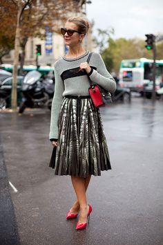 STREET STYLE SPRING 2013: PARIS FASHION WEEK - Red accents brighten up Natalie Joos' skirt and sweater pairing.