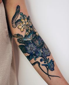 Blue flower And snake tattoo