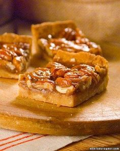Pecan Squares: Falling somewhere between a pie and a cookie, this pastry tops a crisp crust with a thick layer of pecans. The sweet pecan filling offers a delicious variation on the pecan pie-perfect for dessert, lunch, or an afternoon snack. Just Desserts, Delicious Desserts, Yummy Food, Cookie Recipes, Dessert Recipes, Bar Recipes, Pecan Bars, Martha Stewart Recipes, Biscuits