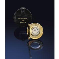 EXCEPTIONAL JEWELS AND PRECIOUS OBJECTS FORMERLY IN THE COLLECTION OF THE DUCHESS OF WINDSOR: THE GOLD COIN WATCH, CARTIER, CIRCA 1940. The circular silvered dial with Roman numerals and blued steel Breguet hands, the watch concealed within a 1893 gold five pound coin, depicting Queen Victoria and St. George, leather pouch, embossed THE DUCHESS OF WINDSOR.