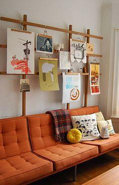 Using wooden slacks/skirt hangers to hang art prints.