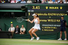 Agnieszka Radwanska tracks down a shot from Serena Williams during the Ladies' final.  Wimbledon 2012.