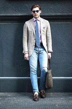 Shop this look on Lookastic:  http://lookastic.com/men/looks/sunglasses-long-sleeve-shirt-tie-blazer-belt-jeans-tote-bag-tassel-loafers/7405  — Blue Sunglasses  — Pink Long Sleeve Shirt  — Blue Polka Dot Tie  — Beige Blazer  — Dark Brown Leather Belt  — Light Blue Ripped Jeans  — Dark Brown Canvas Tote Bag  — Dark Brown Leather Tassel Loafers