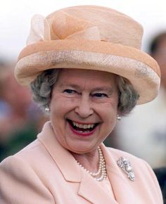 The Queen enjoys a light hearted moment with the Argentinian polo team (not pictured) at the Guards Polo club in Windsor 30 July 2000. The Argentinian team won in extra time 10 goals to 9 against England. (Photo credit HUGO PHILPOTT/AFP/Getty Images)
