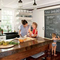 black soapstone counters wood island open shelves The Vintique Object: Five Favorite Kitchens