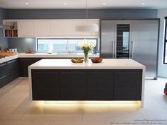 Window over sink, white benchtop, dark cupboards.... This is the way I image it