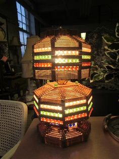 Popsicle stick lamp + marbles - this looks like a fun shop to visit!