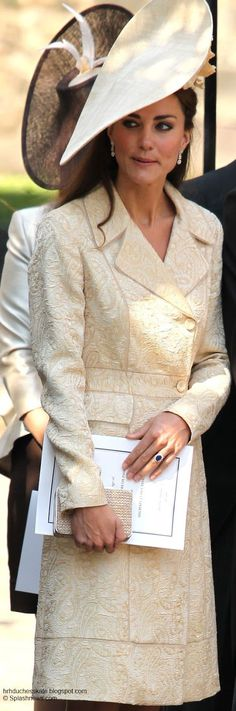 Kate chose to recycle for the event choosing the pale gold coat by Day by Birger/ Mikkelsen,  she wore to Zara Philips and Mike Tindall's wedding last year, Mel Nicholson's 2010 wedding and to the 2006 wedding of Laura Parker Bowles. Again Kate obviously wanted the attention firmly on the athletes and not her sartorial choices hence recycling a piece that has been seen three times before.