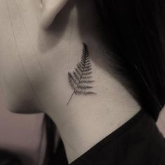 Fern leaf tattoo on the left side of the neck behind the left...