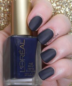 Grey Corset, a deep grey-blue polish that dries with a matte finish