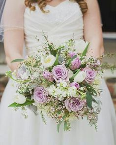 Lovely Bridal Bouquet Arranged With: White Tulips, Lavender Tulips, Lavender Roses, White Stock, Waxflower, Dusty Miller, Several Varieties Of Green Seeded Eucalyptus + Additional Greenery & Foliage