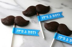 Make your own chocolate mustache pops to hand out as baby shower favors.