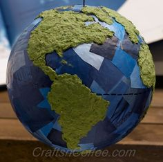 Hands-on Earth Day craft for kids shows how to repurpose papers and make an Earth Day globe. CraftsnCoffee.com.
