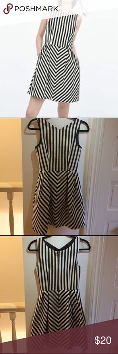 ZARA Striped Party Dress Very cute striped A-line, V-neck party dress from Zara. Super slimming and cinches nicely at the waist. Just over knee length on most. Never worn, in perfect condition. Zara Dresses