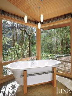 This Freestanding Tub Sits On A Custom Designed Stand Made From Wood And Waterjet