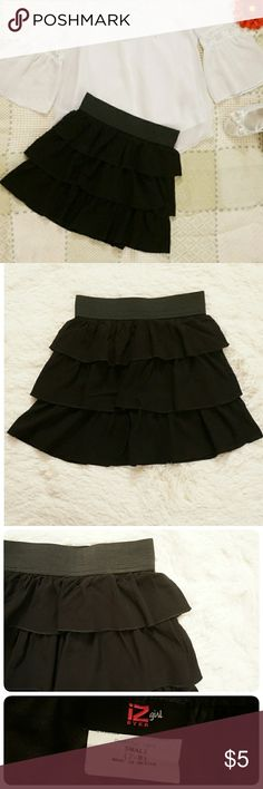 Girls IZ Amy Byer Tiered Skirt Fun and frilly three tiered ruffle skirt. Elastic waistband for a flexible fit.  Polyester/rayon. Machine wash. Very gently used, in great condition. IZ Amy Byer Bottoms Skirts
