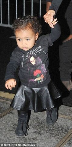 North's signature look is a cool jumper teamed with leather and some black boots...