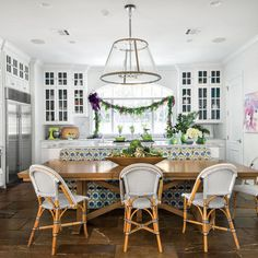 An Austin, Texas kitchen featured in @southernliving is ready for the holidays, complete with our Riviera Chairs.