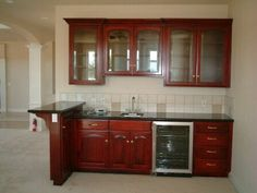 wet bar: small fridge & microwave, no sink or top cabinets.