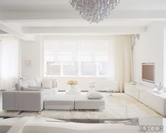 You'd be hard-pressed to find a drop of color in this living space decorated by Nina Seirafi. The Chelsea loft gains glamour from surfaces and textures, including a plush cream-color rug,  Lucite chairs, and a lacquered credenza by the designer.    - ELLEDecor.com