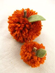 pumpkin pom pom balls -- would be good for the kids as an afternoon craft.