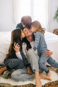 Mom and kids kissing and hugging in the morning at home. by BONNINSTUDIO - Family - Stocksy United Kids Kiss, Model Release, Kissing, The Unit, Stock Photos, Mom, Couple Photos, Adobe, Fonts