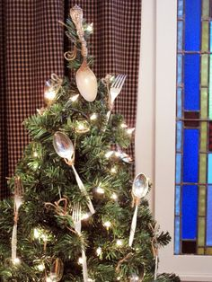 a tree with vintage silverware tied with brown twine