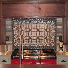 A splash of red, coupled with black and white cement tile, is the perfect touch for this kitchen!