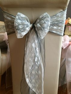 No chair cover with silver / grey organza sash and white lace.  Available to hire for weddings and events in Swansea, Cardiff, Neath, Bridgend, Llanelli, Carmarthen and surrounding areas of South Wales from www.affinityeventdecorators.com