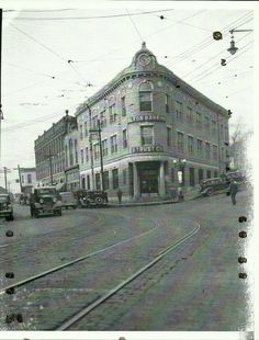 Alton Banking and Trust Co.,,we know it as the Wedge Bank Building,check out all the old cars,,view to the west. on Broadway.