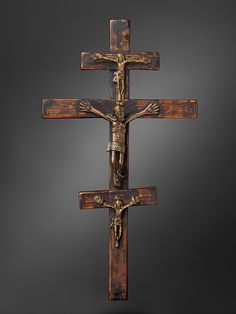Crucifix Date: top small figure 18th–19th century; central large figure 16th–17th century; bottom small figure 18th–19th century Geography: Democratic Republic of the Congo or Angola, Lower Congo region Culture: Kongo peoples, Kongo Kingdom Medium: Wood, brass Dimensions: H.10 1/4 x W. 5 11/16 x D. 1 in. (26 x 14.5 x 2.5 cm) Classification: Metal-Sculpture Credit Line: Gift of Ernst Anspach, 1999 The Metropolitan Museum of Art, New York Accession Number: 1999.295.15