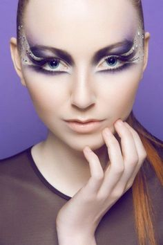 Artistic crystal enhanced purple and white fantasy make-up by Dana  Cole Photography.