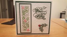 Sue Wilson holly striplet & filigree holly die, Tattered Lace Winter Wishes die & Creative Expressions Swirling Holly embossing folder. Holly striplet die mounted on velum & coloured from behind with Spectrum Noir pens & added red gems for berries