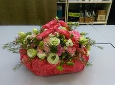 Flowers in a cloth bag. Using eustoma, spray roses, wax flowers, gerberas