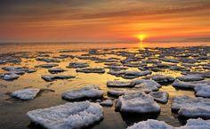 Ice floats on Lake Huron during a winter sunrise near Port Hope, #Michigan. Credit: John McCormick Shutterstock