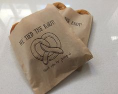 """These """"We Tied the Knot!"""" paper bags are perfect serving soft pretzels as wedding favors. What better way to thank guests for coming than a fitting phrase and a tasty treat?!"""