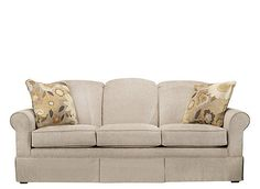 Give your living room a feeling of refinement with this Barrow chenille sofa. It's so elegant and classic with its rounded back, skirted bottom, roll arms and welting. Plus, the neutral upholstery is easy to decorate with, and the floral pillows make a major statement while complementing this sofa's transitional style.