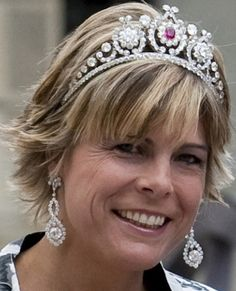 Princess Laurentien of The Netherlands wearing a tiara made for Queen Emma in 1890 by Royal Beeger. The tiara can be topped by five 12-pointed stars which Emma received as a wedding gift in 1879, and is usually worn with a diamond (not ruby) center by Laurentien, Maxima, and Beatrix ---  usually with those lovely earrings.