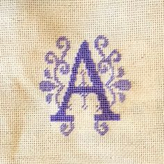 1 down, 25 left to go.  Prepping for a pastel alphabet tree.  #crossstitch #alphabet