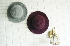 This Burgundy Hat with Brim was hand crocheted from Italian yarn, that isn't scratchy at all and consists of 50% Merino Wool and 50% Acrylic. Acrylic retains shape and elasticity. The wide brim hat...